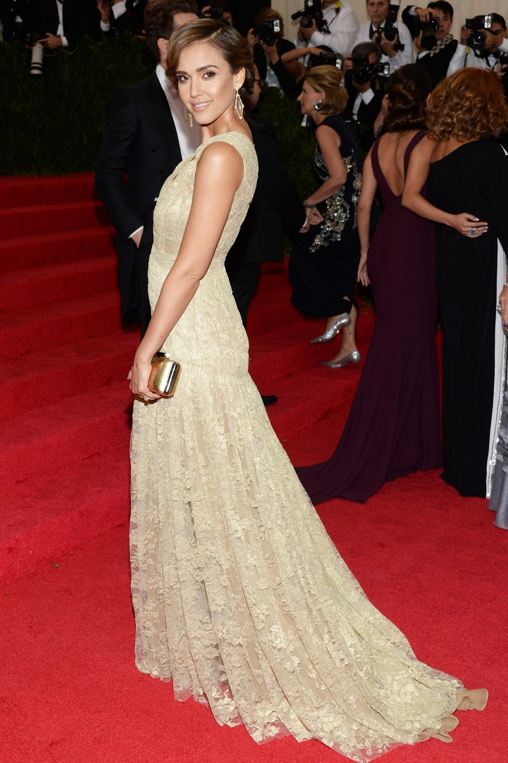 Jessica Alba wore a Diane von Furstenberg dress and clutch.