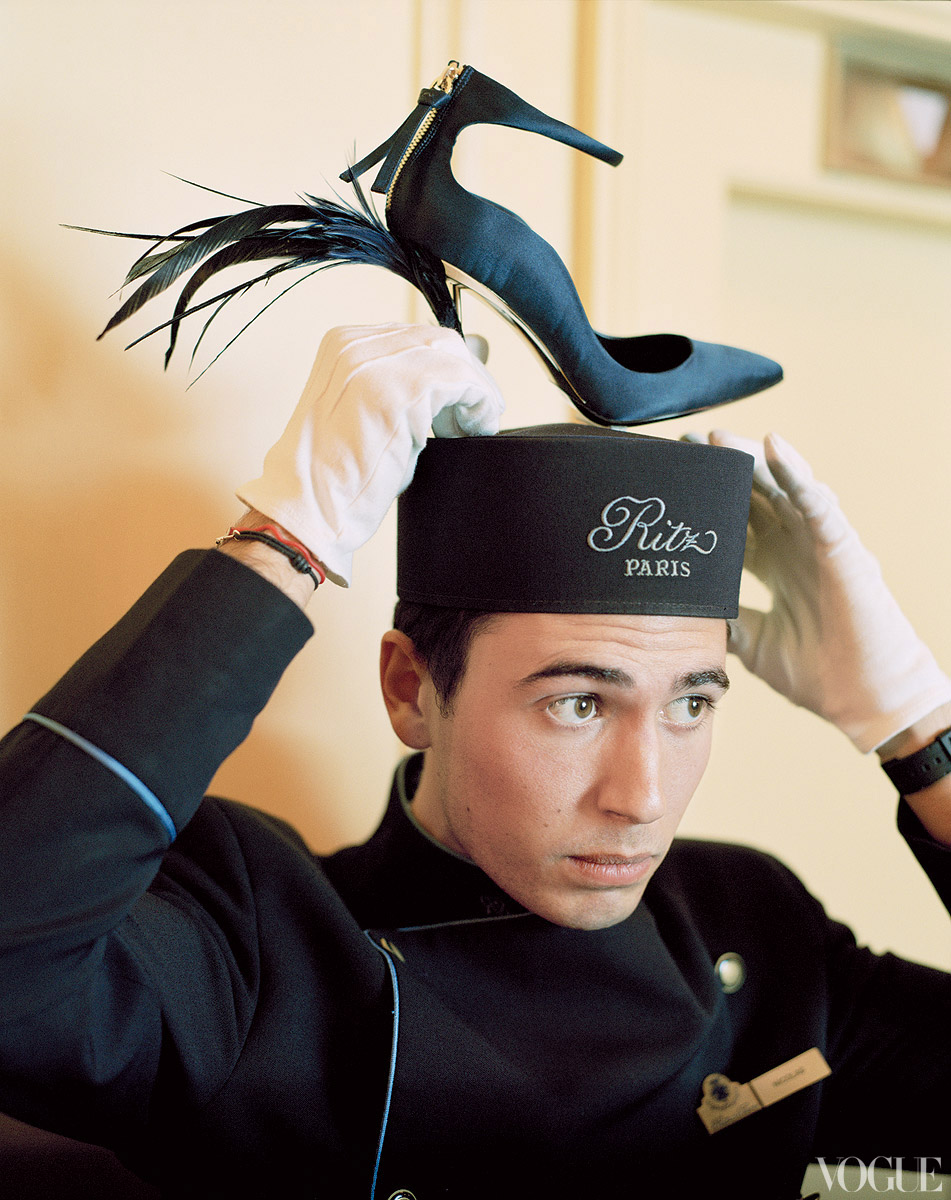 Roger Vivier silk-and-feather pump on his cap.