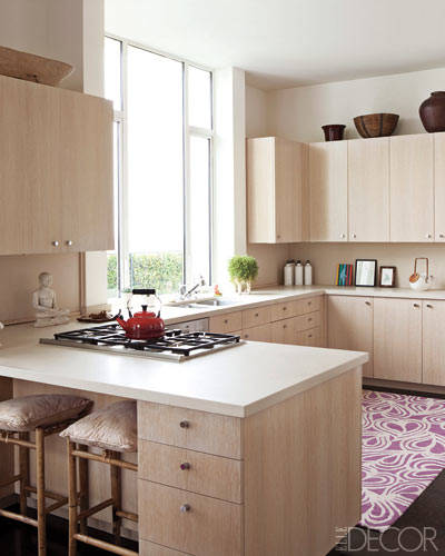 White washed oak cabinetry and CaesarStone  countertops.