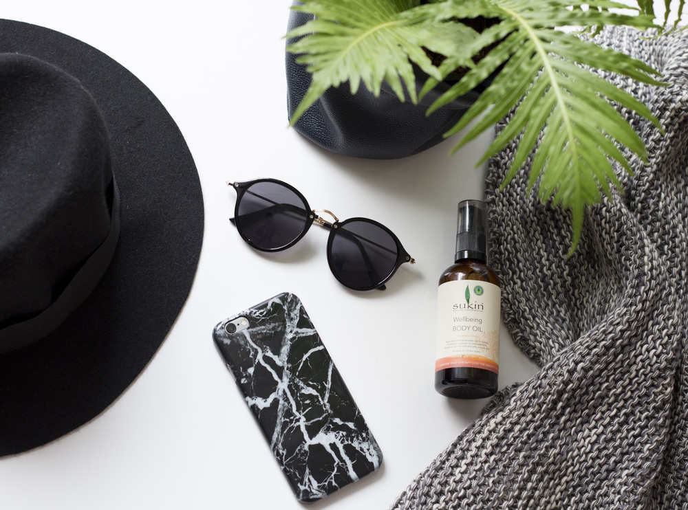 Product Photography & Styling    Hat, Sunglasses & iPhone Case -  Spencer Street Store  Throw - Millie Archer Online  Skincare - Sukin