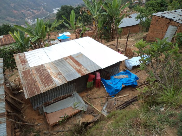 Most people have used the tin from their roofs to make a new shelter. They need new roofing tin before the monsoon rains start so their roofs won't leak.