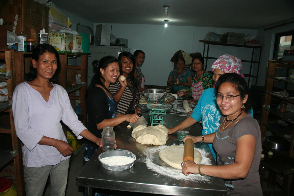 The women working together in the bakery