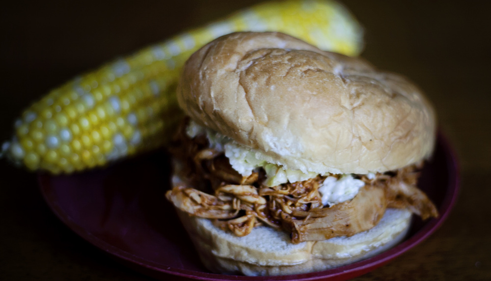 "For the third day of the Dinner: The Playbook Challenge, I decided to make the Pulled Chicken Barbecue Sandwiches. This kind of felt like cheating. I knew it would go over great. One thing my girl loves is barbecue chicken. I even named my homemade sauce after her. However, we don't normally shred it and put it on a bun, so I called it different enough to count. We served it with corn on the cob and roasted eggplant. The corn was gobbled up, but the eggplant was treated as though it had been doused in battery acid rather than olive oil. ""Just a bite! Just ONE bite! Don't give me any more!"" Ah, well. She did choose a cherry popsicle over ice cream for dessert, reasoning, ""the popsicle has fruit in it."" I didn't have the heart to correct her."