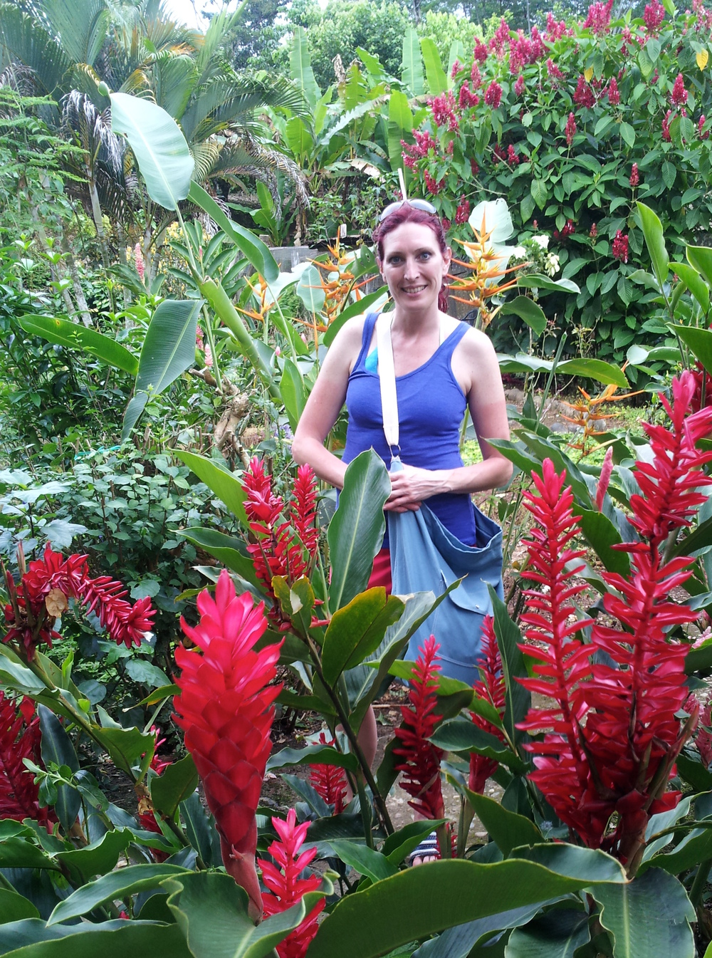 Toting the bag in a maze of gorgeous jungle flowers near Tena