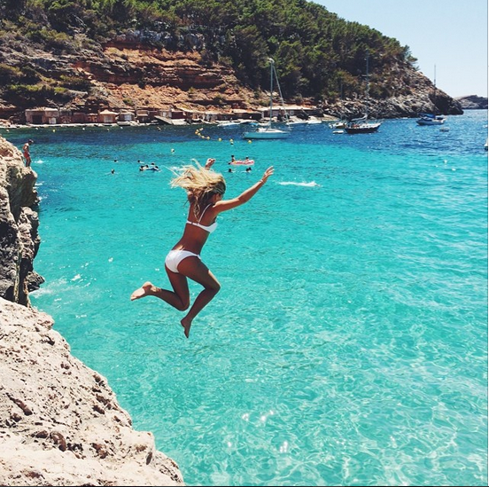 Who wouldn't want to do a little cliff jumping into water that gorgeous!? Natasha Oakley in Ibiza.