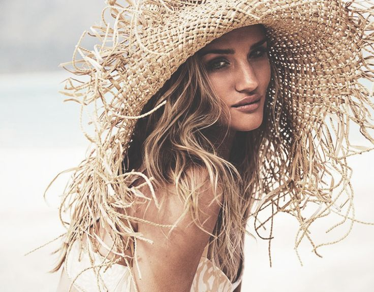 Mega beach babe,  Rosie Huntington Whitely .