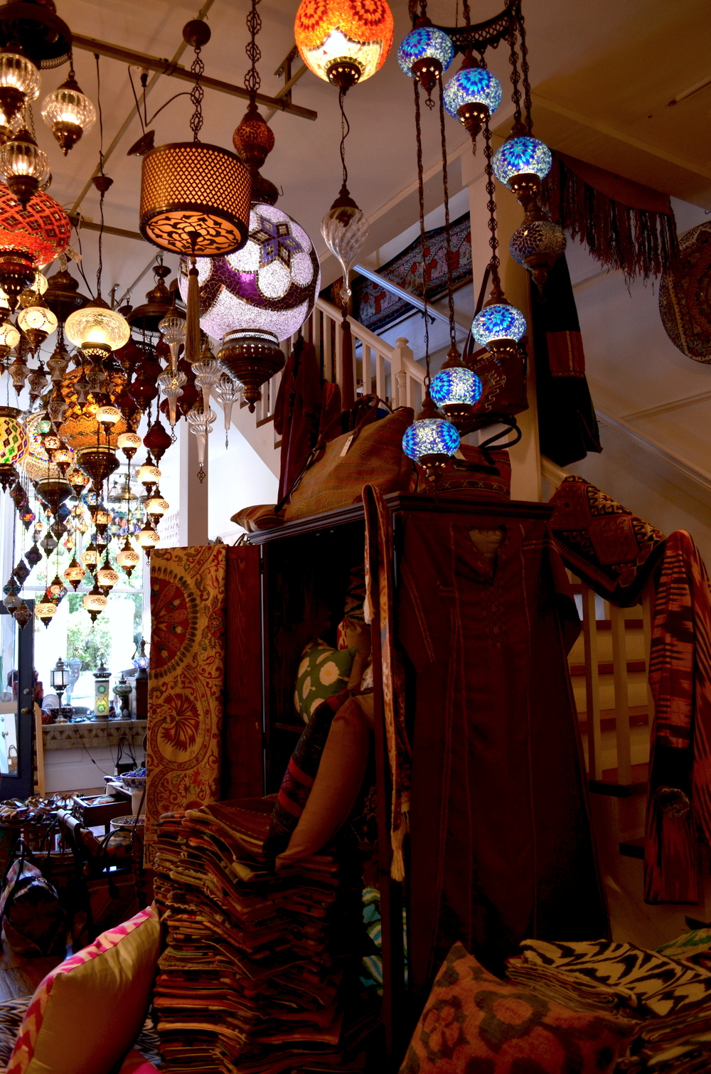 My favorite little souk-like shop. Glittering lanterns, textured pillows and woven boots!