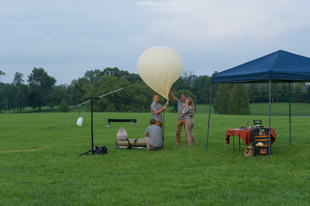 The Mesoloft team filling one of our latex balloons