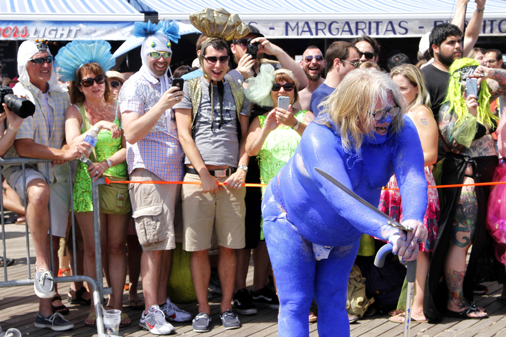 He blue himself for the Mermaid Parade.  That's dedication.