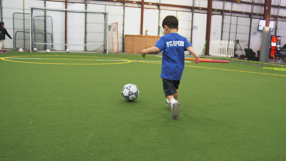 Young boy dribbling .jpg