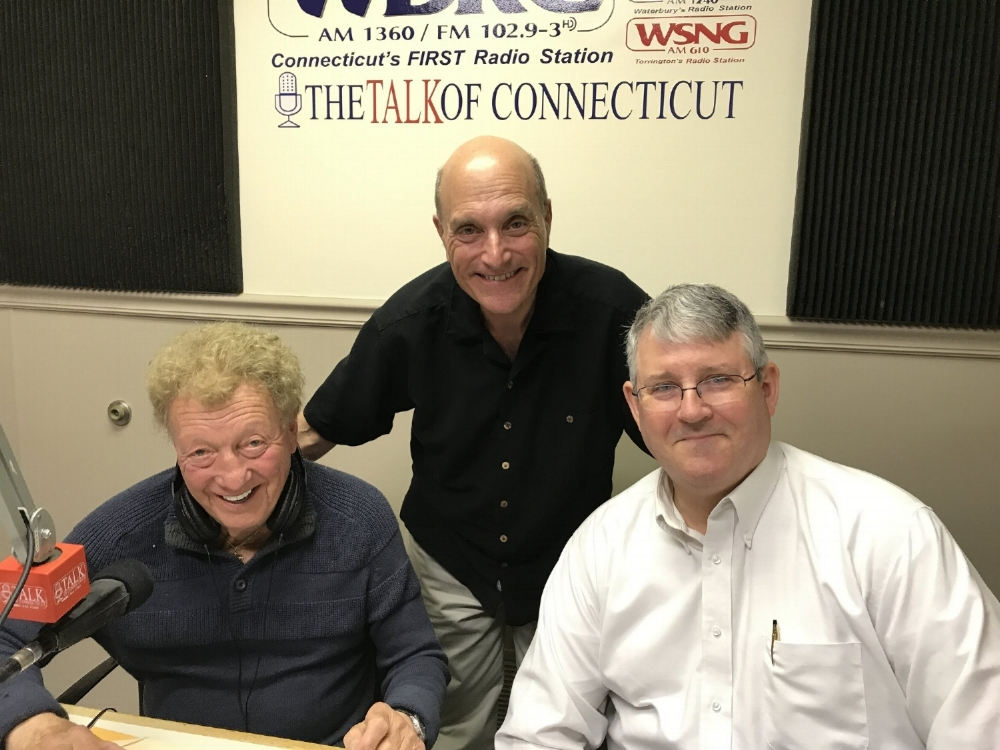 Pictured (L-R): Brad Davis, Dan Lovallo (standing), and Thomas Burr