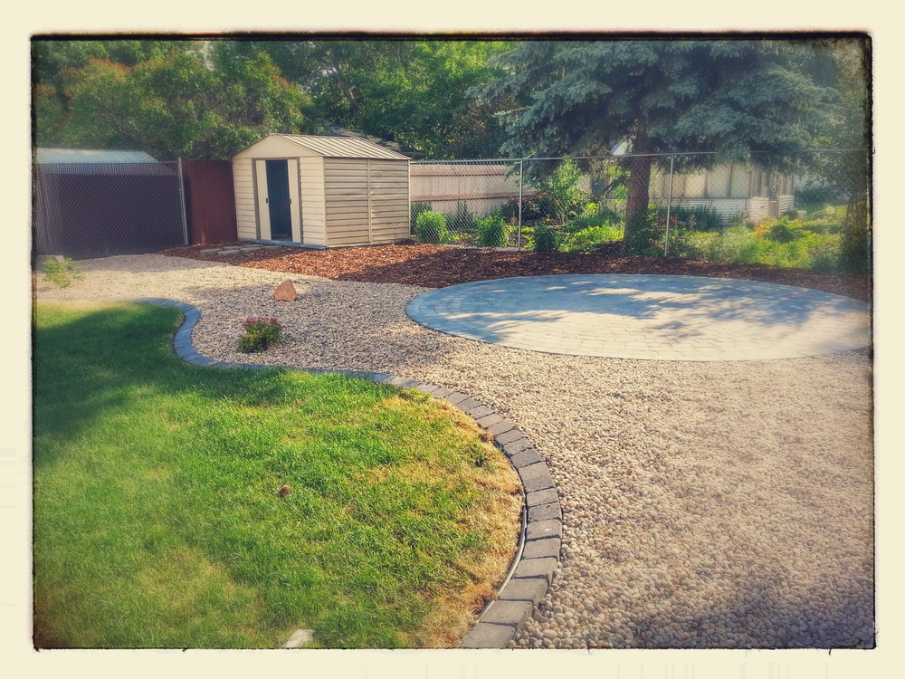 Complete Backyard Renovation New Circle Pad Cobble Edge