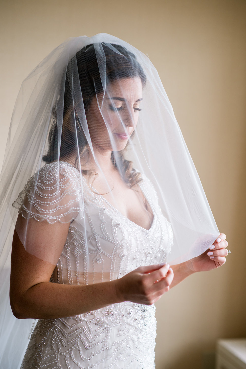 Stony Hill in Wedding Bride holding her veil