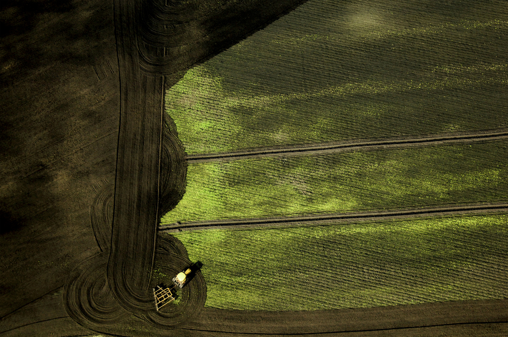 "Figure 4: Breaking and turning the earth. ""Turning the field, Lodi, California"". Photograph: Christopher Line"