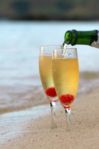 Champagne being served at the private beach