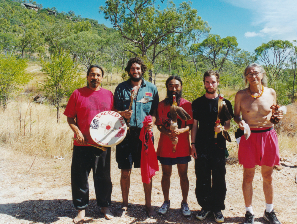 Gorran Gilkerson (2nd left) at Split Rock Aboriginal art area near Laura, Queensland, Australia
