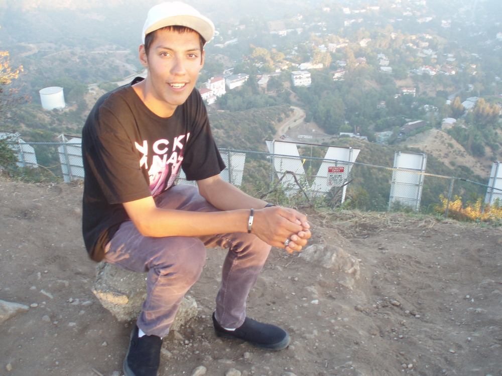 Cesar Martin Sanchez above Hollywood sign
