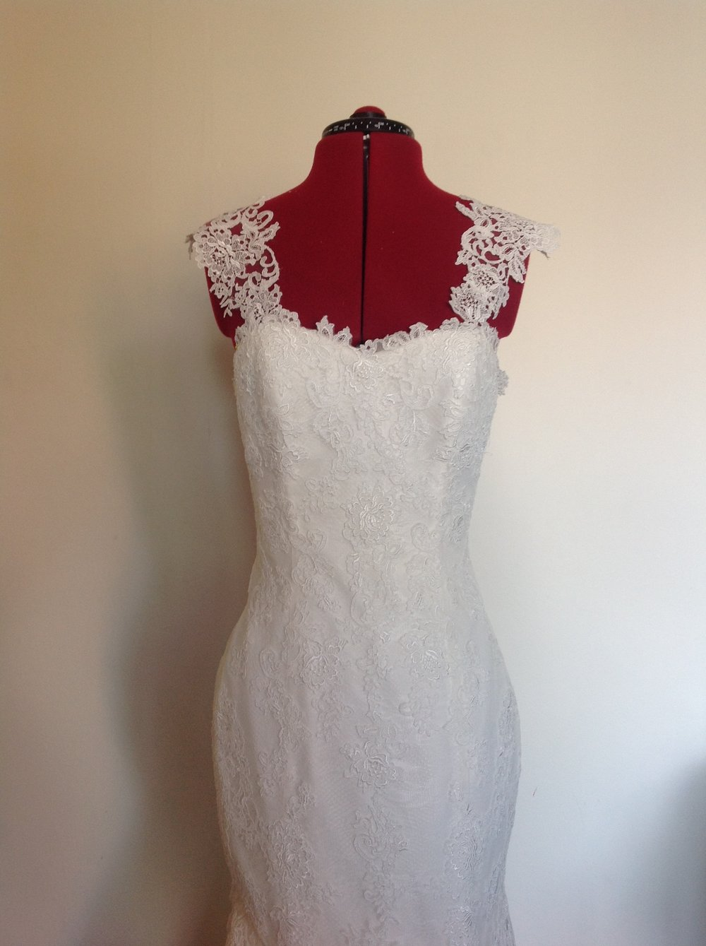 4256bc08a1 The lace on this dress was appliquéd on in pieces