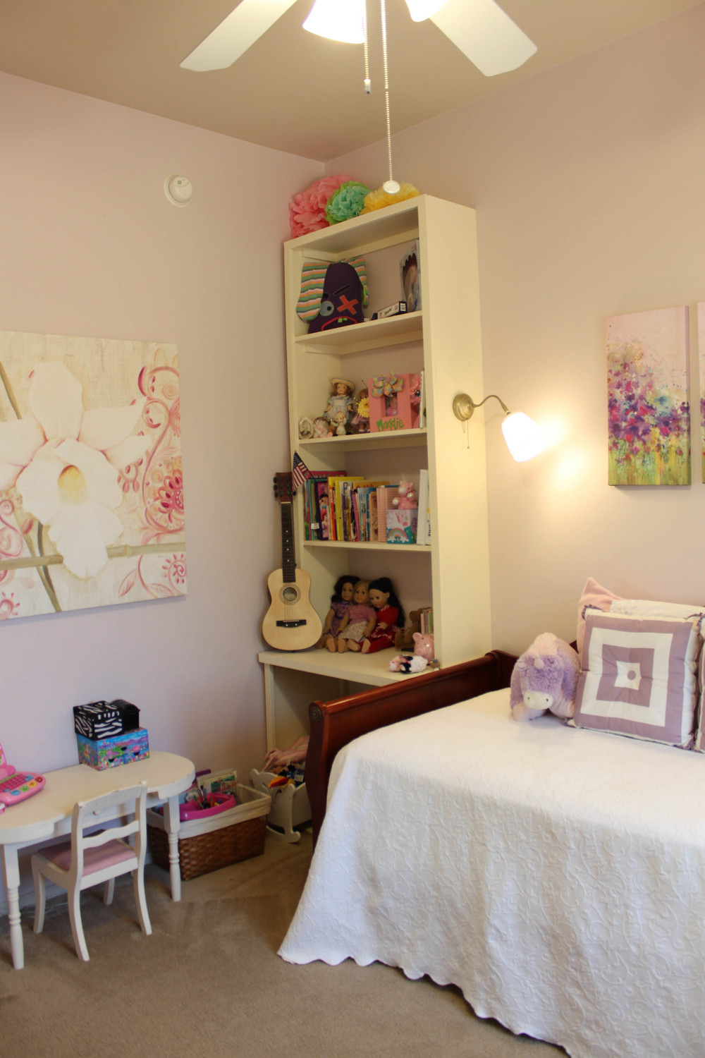 girls lavender room with built-ins and gold sconces