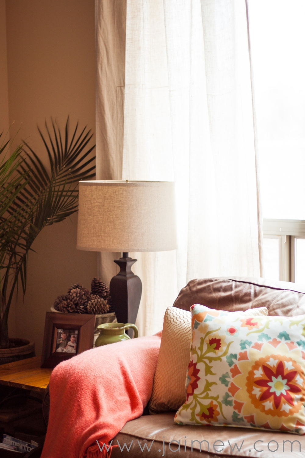 coral ombre throw and floral pillows for summer