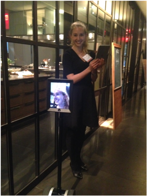Anita Ostrovsky, the Gravitas Office Administrator, greeted arriving guests with the Gravitas Robot.  #Innovation