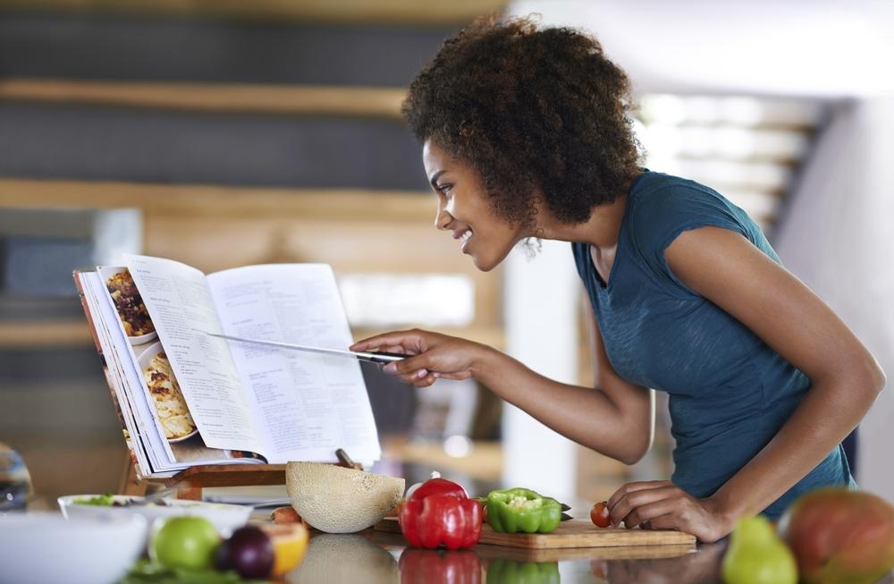 iStock_Woman Reading Recipe Over Cutting Board.jpg