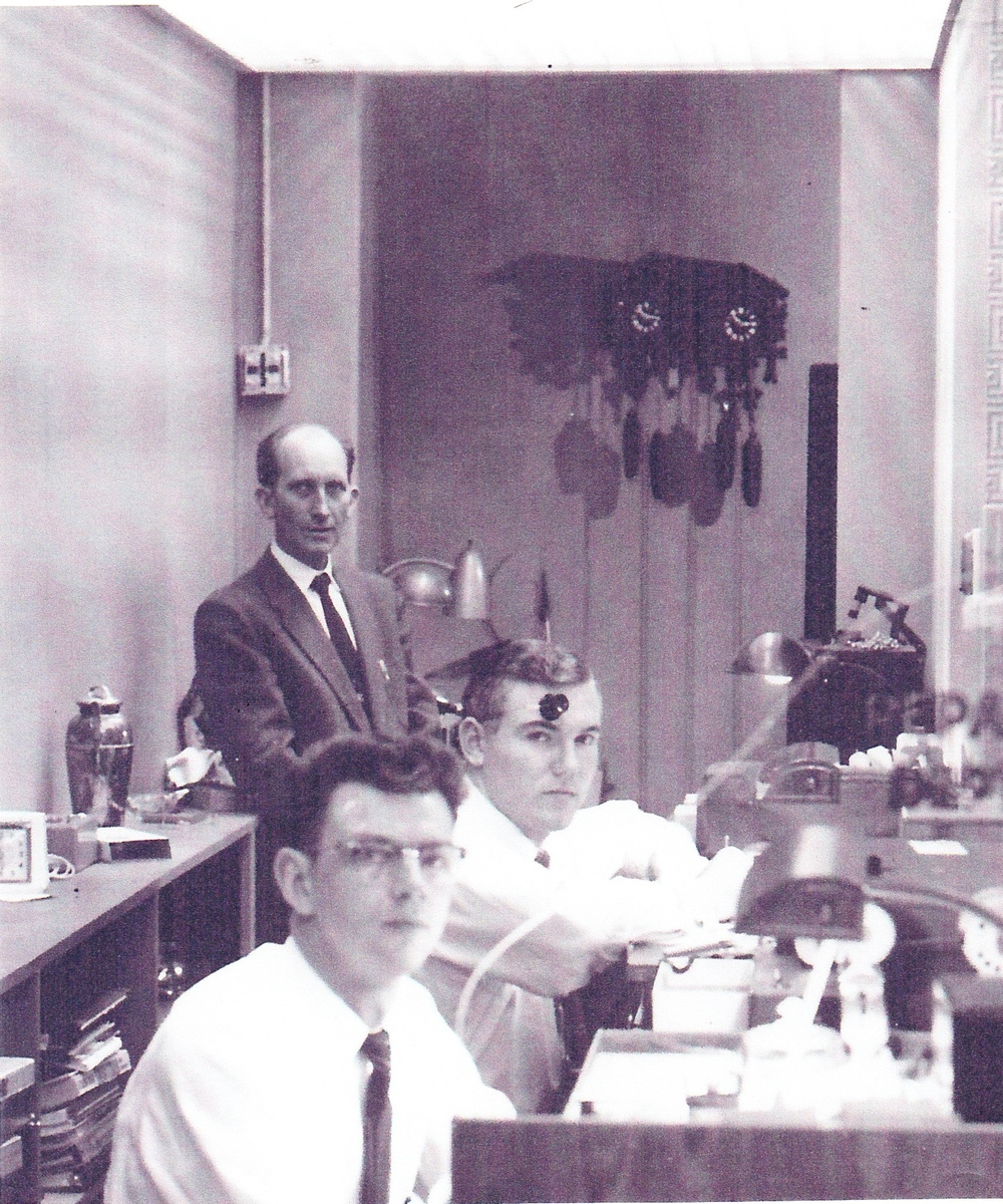 Cloyd Garwood (rear), watchmaker Jim Leazer (center), and watchmaker Earl Reider (front) in the 1950s.