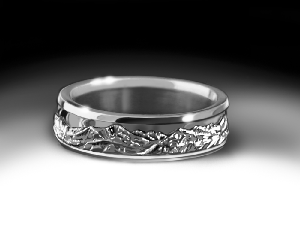 The Rocky Mountains as seen from Fort Collins encircle this detailed and unique ring. Exclusively at Garwood's Jewelers, each piece is made to order to fit your finger.