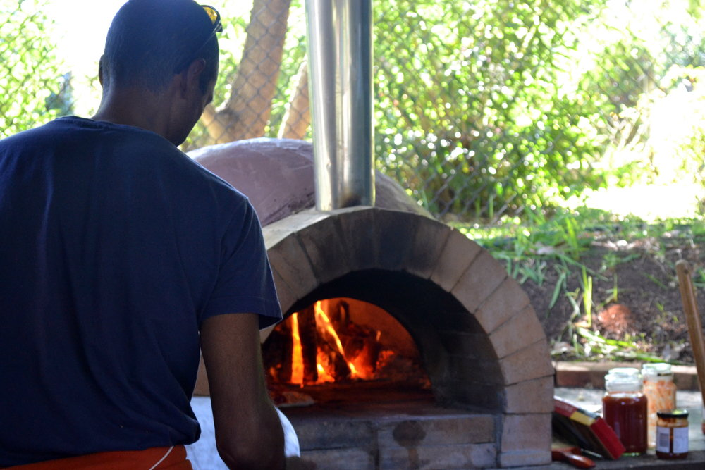 Cranking out the piizas from our pizza oven