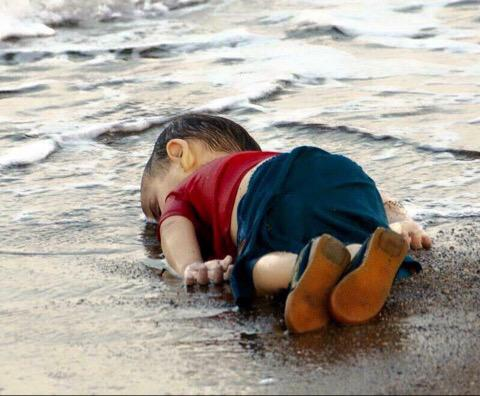 The body of Aylan Kurdi, a 3 year old Syrian refugee, lays on the Turkish coast.  [Twitter.com]
