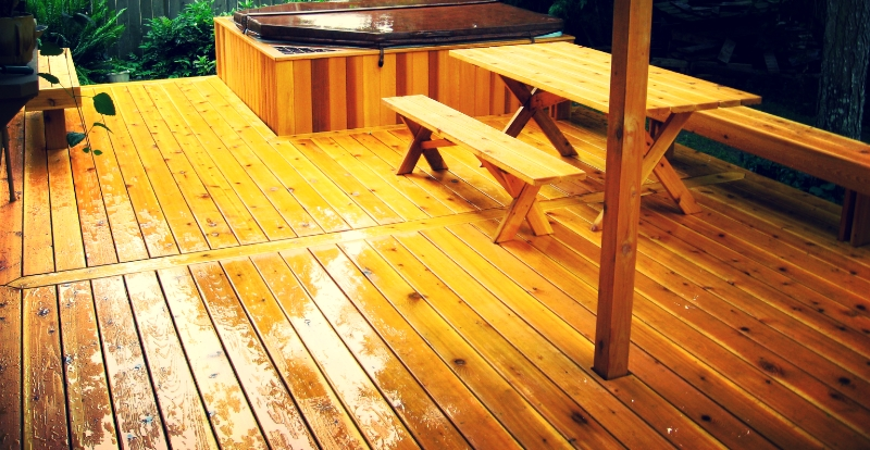 Red cedar deck, patio furniture, and jacuzzi platform.