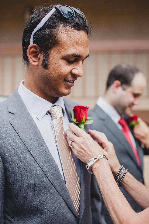 poco-diablo-resort-groom-getting-boutineer-put-on