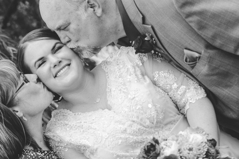 bride-and-parents-be-cheek-kiss