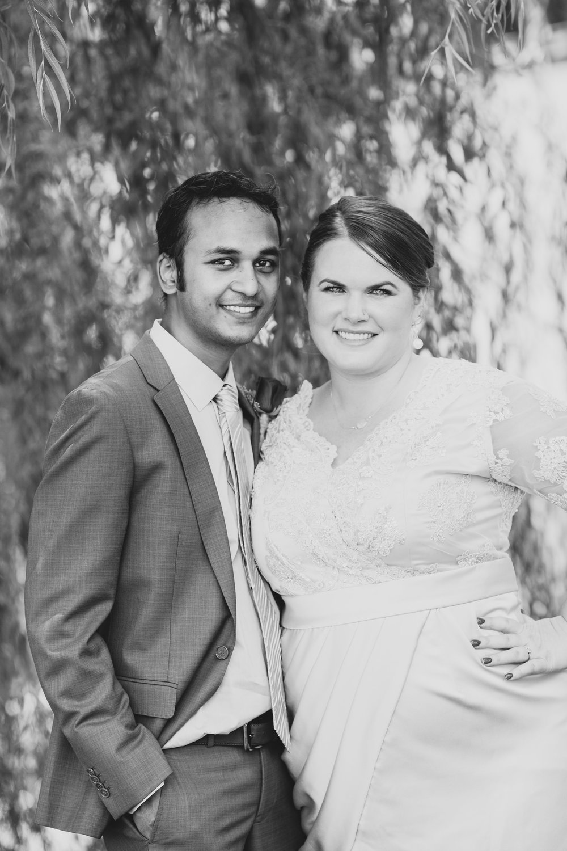 black-and-white-bride-and-groom-under-tree-kj