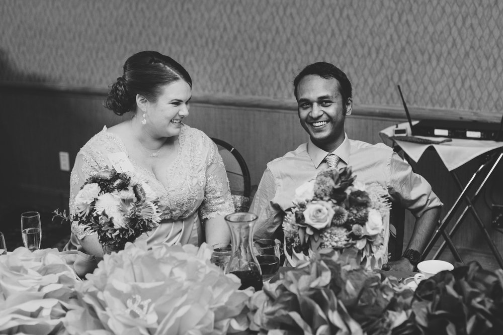 jessica-karthik-bride-and-groom-laughing-reception