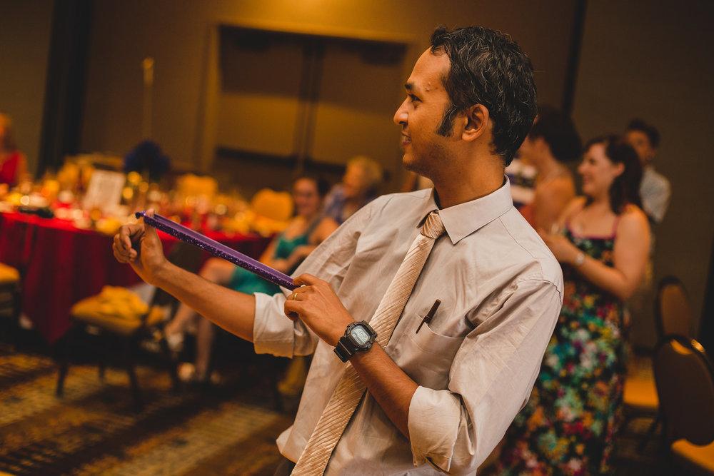 karthik-groom-throws-garter-wedding