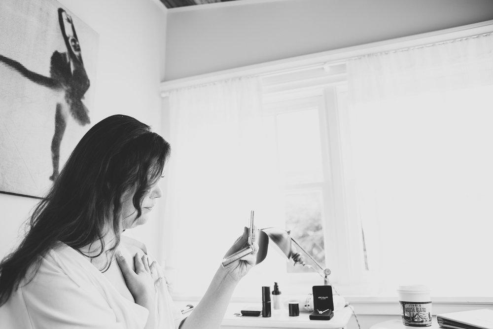 bride-tiffany-looking-into-makeup-mirror