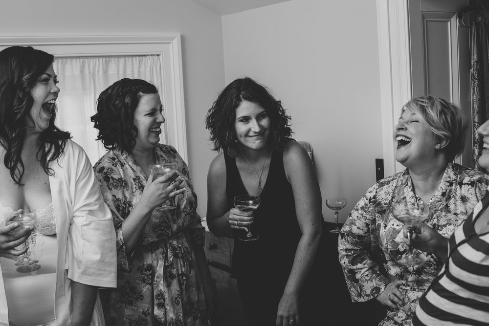 bridesmaids-laughing-after-toast-ny