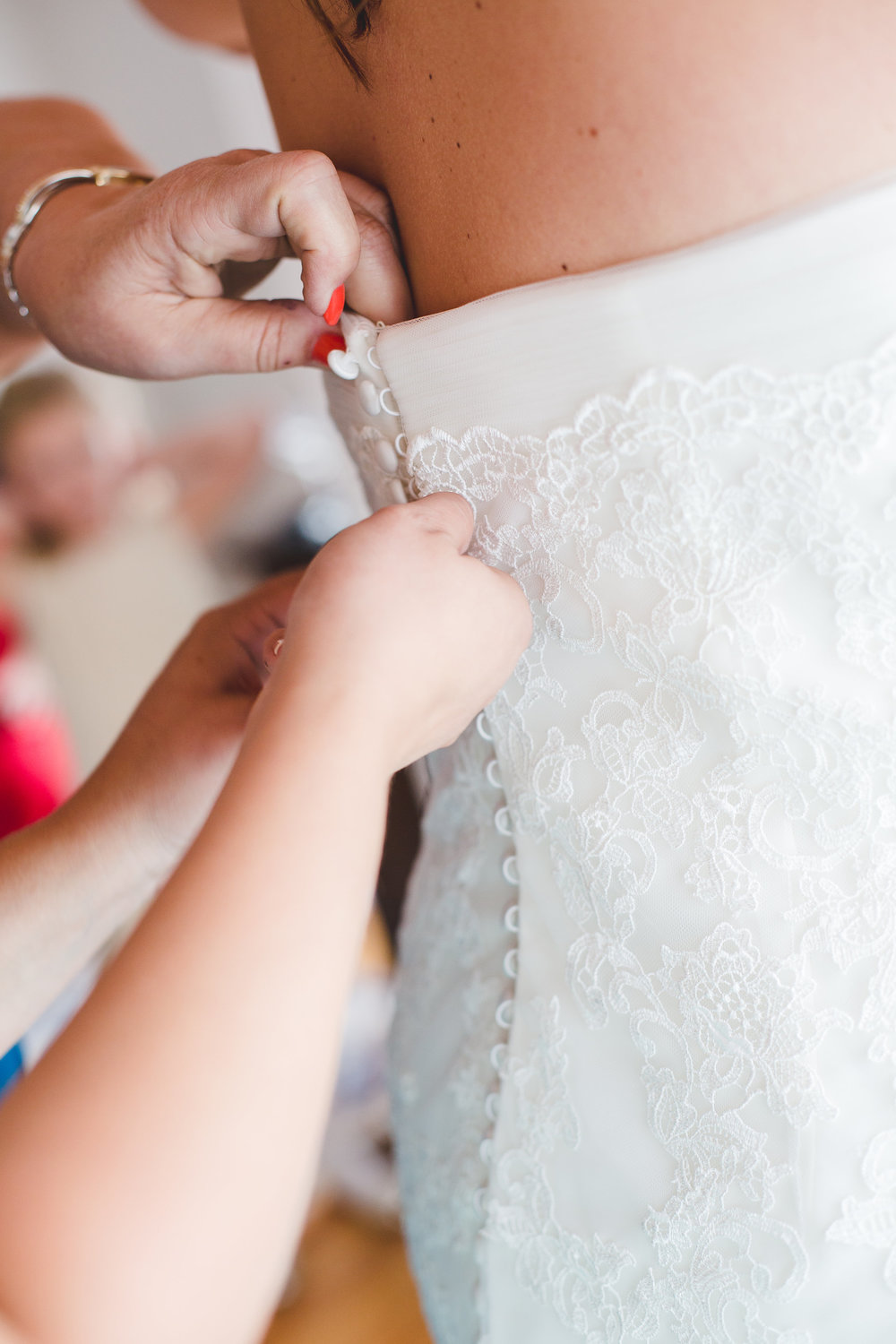 wedding-dress-being-laced-up-tiff