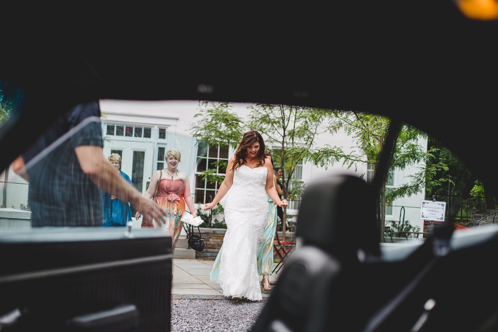 bride-walking-up-to-car-ithaca