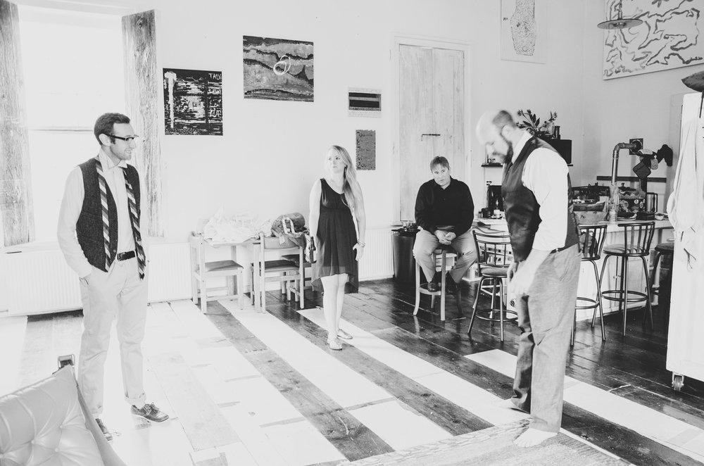 groom-and-groomsman-joking-waterburg-chapel