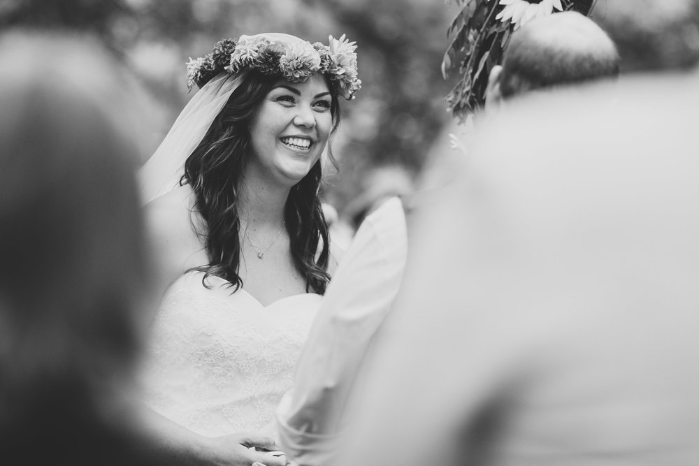 black-and-white-bride-smiling-during-ceremony-tiffany