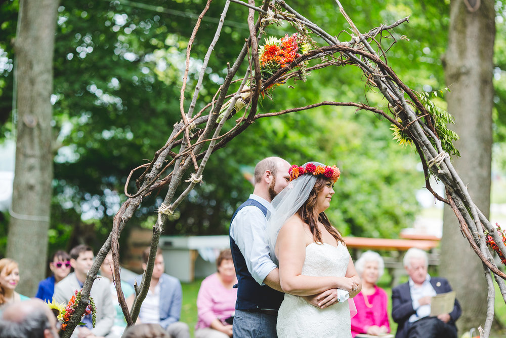 bride-and-groom-embrace-wedding-ceremony-ny-tiffany-roy