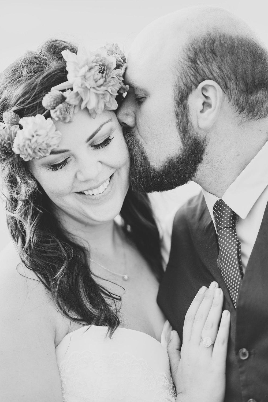 groom-kissing-bride-tenderly-bw-ithaca-tr