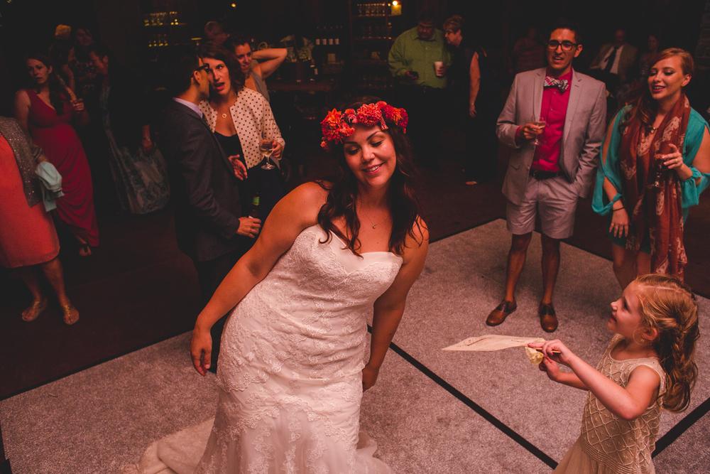 flower-girl-cooling-off-bride-dance-floor-tr