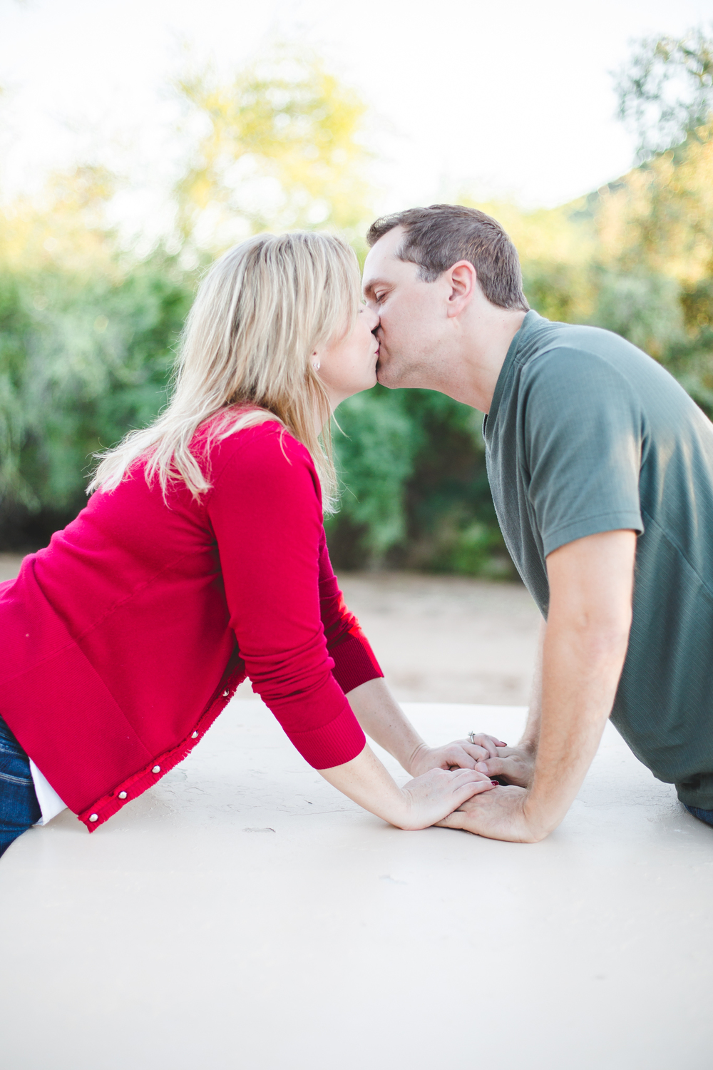 jen-john-picnic-table-engagement-picture-kiss-color