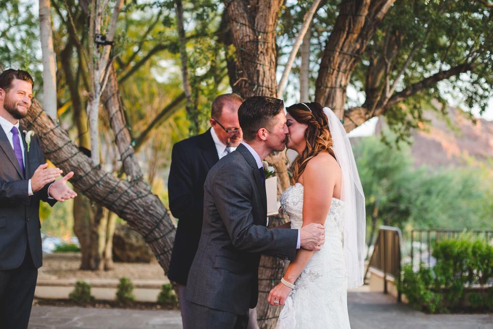 lc groom kissing bride
