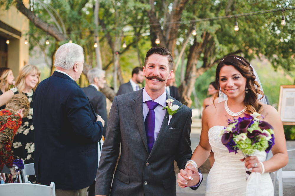lc wedding married couple walking isle