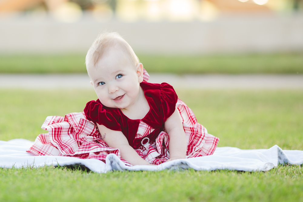 cutest baby ever sitting on blanket at the park amelia