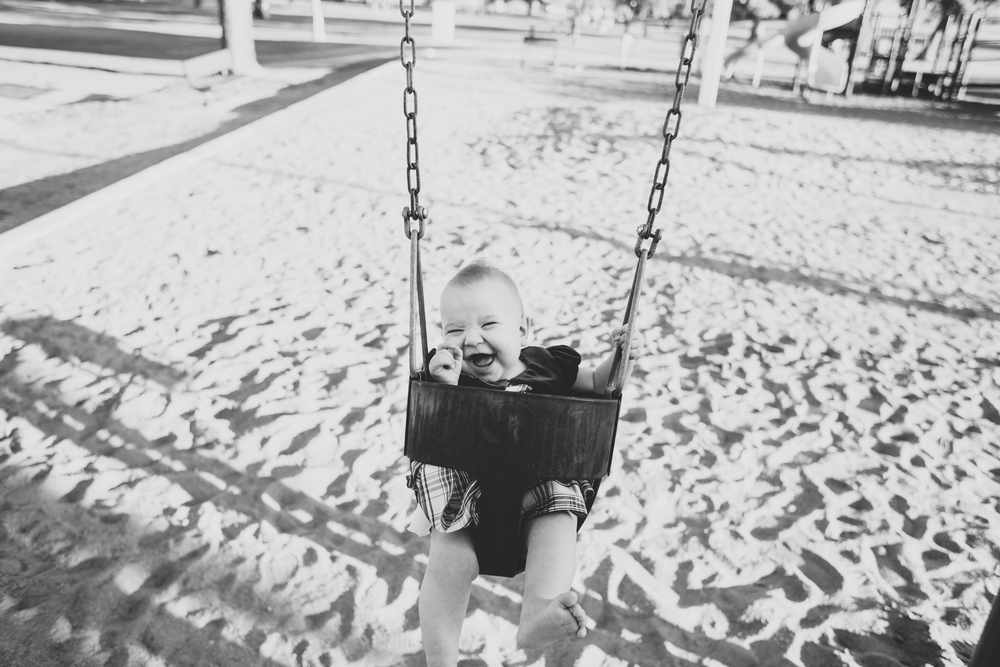 cute baby on the swings at the park az amelia